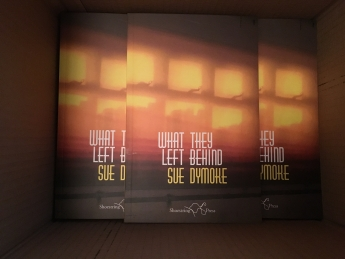 Copies of What They Left Behind: waiting to spring from their boxes for your reading and listening pleasure
